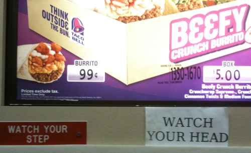 Taco Bell signs: Watch Your Step, Watch Your Head