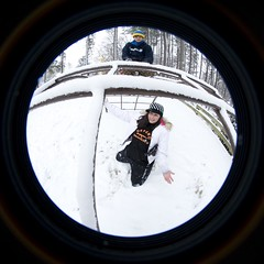 Shooting Down (pgpanic) Tags: park trees winter dog selfportrait snow lauren nature weather playground sarah sisters digital snowman woods nikon lab frost swings freezing pug wideangle slide rob pitbull fisheye gloves flurries paths fullframe noelle 8mm element d3 bestfriends snowday snowballfight nikond3 nikonwideangle