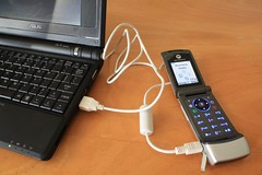 The EEEPC (or other USB port) can charge a cellphone