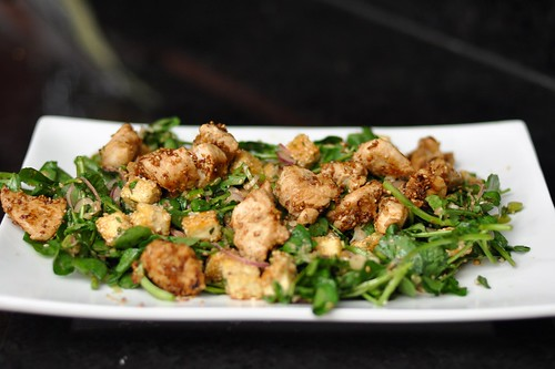 Watercress salad with sesame tofu and ginger chicken in a spicy Asian vinaigrette