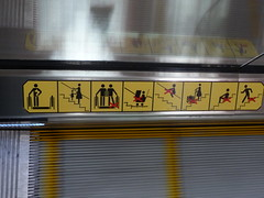 So many stick figures (cyanocorax) Tags: reflection sign escalator instructions warnings movingwalkway redx
