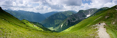 Wide look (P.Sobczyk (away)) Tags: blue light shadow summer sky people mountains green grass clouds daylight nationalpark rocks path stones poland tourists route trail edge pick hillside tatry