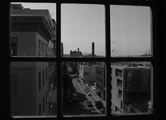 Seattle Urban Landscape (Rennett Stowe) Tags: seattle urban streets window loft cityscape oldbuildings smokestacks urbanlandscape stuckinside citystreet windowpanes urbanstreetscene urbanstreet urbanenvironment cityliving oldseattle cityescape loftwindow loftliving tryingtoescape blackandwhitecity oldschoolphotography lookingoutofawindow citystreetscene blackandwhiteseattle historicseattle thecitywithin urbanwindow seattleblackandwhite seattle2009 lifeoutthere seattlelofts oldseattlebuildings sixwindowpanes 1940sstylephotography thestreetdownbelow thestreetsofcity oldfacorysmokestacks toughurbanenvironment lookingintoacity lookingtothestreetbelow lookingdowntothestreetbelow olderstylephotography captivemind prisonerofmymind mindsprisoner seattleurbanlife