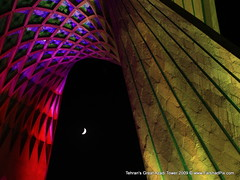 i believe in ONE (FarshadPix) Tags: lighting city urban moon news streets building tower beautiful architecture night composition photography 50mm lights colorful photographer iran small great large photojournalism moonlight iranian tehran  sq  freelance azadi  exposures farshad       canon30d  1387          palideh     farshadpixcom