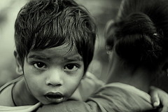 mamma's child | Kolkata (arnabchat) Tags: street portrait india monochrome look kid eyes dof child mother explore favs kolkata bengal calcutta bangla westbengal 50f18 canon400d arnabchat arnabchatterjee