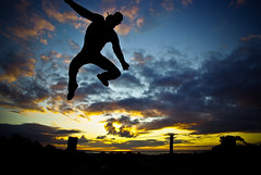 Principles of Flight (lachlantelfer) Tags: sunset colour silhouette jump flight flickrunitedaward