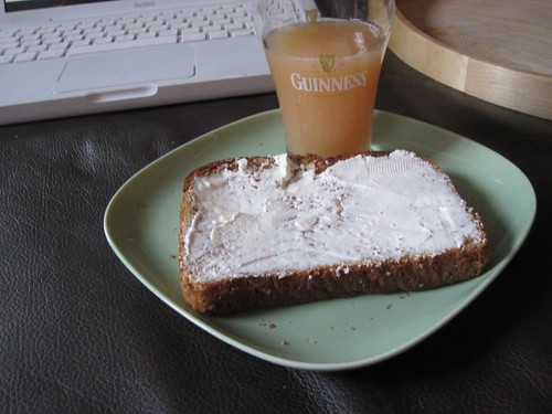 Wheat toast with cream cheese and a glass of grapefruit juice