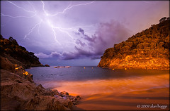 catch of the day (almibag) Tags: longexposure sea storm beach night clouds spain rocks thunderstorm lightning sodiumvapor giverola efs1022mmf3545usm canoneos400d alanbagge almibag