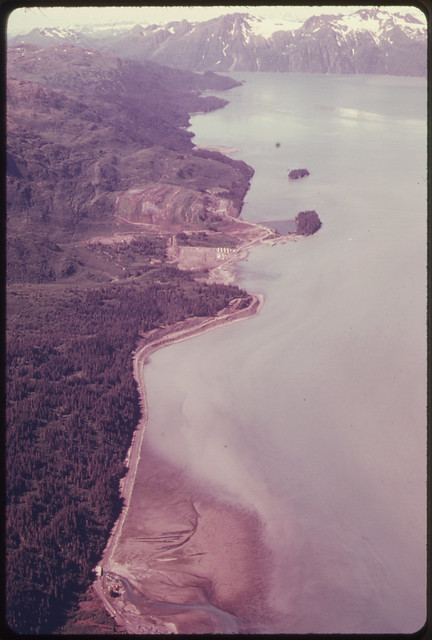 View West Along South Shore of Port Valdez Showing Road Under Construction to Provide Access to the Future Terminal Glacier in the Distant Center of the Picture Is the Anderson081974 by The US National Archives