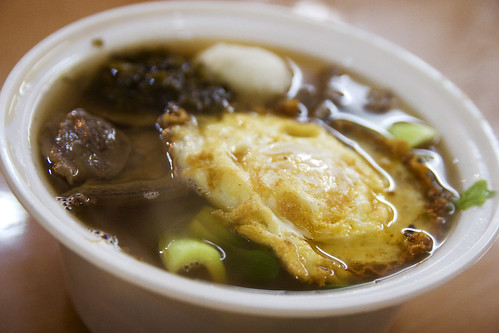 beef noodle with a fried egg