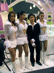 Lucky guy (Roving I) Tags: girls food promotion vertical thailand highheels boots bangkok events models fluff exhibitions seethrough cuffs miniskirts midriffs fluffybras