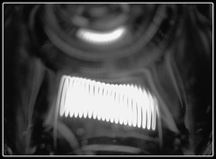 Inside The Light Bulb (locksmith in aylesbury) Tags: lighting light shadow blackandwhite macro glass lightbulb closeup bulb mono blackwhite exposure flickr fuji dof bokeh monotone depthoffield burning aylesbury amateur s9500 effect hdr locksmith picnik filament shutterspeed haddenham illuminating photomatix fujis9500 tonemapping locksmithinaylesbury aylesburylocksmith