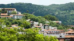 Taxco (Rockanroll Casanova Cirett) Tags: orange white church mexico cityscape 169 taxco guerrero canonef28135mmf3556isusm canon40d