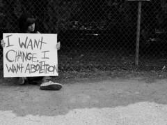 keep your coins, i want change 137/146days of love. (Jennifer Hamilton (NewYorkEyes)) Tags: white black freedom child message olympus teen converse change asphalt slavery blacktop teenage abolition e420 love146