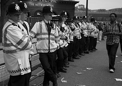 The Metropolitan Police (Chris JL) Tags: street uk carnival blackandwhite bw man men race candid streetphotography police surprise blackman glance nottinghill decisivemoment choral whitemen metropolitanpolice londoner nikond90 racialtensions iwishtheworldwasdifferent chrisjl