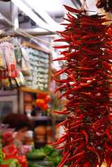 Market, Barcelona (Matevz Umbreht) Tags: barcelona travel red summer plant blur hot flower green tourism nature floral beauty grass yellow shop retail fruit garden la spain colorful mediterranean market bokeh vrt background stall tourist catalonia spanish destination peppers marketplace catalunya grocery shoppers espania ozadje rumeno rastline rdee