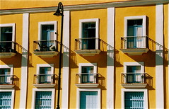 Havana Windows & Balconies (ChrisGoldNY) Tags: travel windows film latinamerica americalatina yellow scans forsale havana cuba viajes latin albumcover balconies caribbean bookcover nondigital cuban habana vacations cubano supershot 5photosaday latinaamerica challengewinners achallengeforyou chrisgoldny chrisgoldberg chrisgold chrisgoldphotos