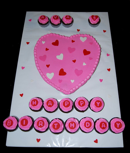 Pink red and white Valentine themed 3rd birthday cupcake cake