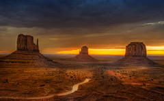 Skyline (Wolfgang Staudt) Tags: travel red summer arizona sky usa mountains beautiful yellow clouds sunrise landscape utah spring amazing nikon sandstone butte desert nikond70 sigma 2006 northernarizona wilderness navajo monumentvalley vacancy navajoreservation soe lonelyness coloradoplateau navajoindianreservation blueribbonwinner navajonation travelphotographie din abigfave tsbiindzisgaii wolfgangstaudt sigmaaf4561020dchsm platinumphoto anawesomeshot impressedbeauty skycloudssun 66111 superhearts tribehorizon goldstaraward