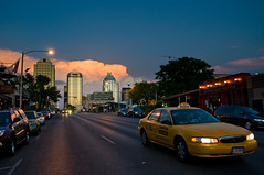 Yellow Taxi (Skept) Tags: sky orange usa yellow night clouds austin buick cityscape texas cloudy taxi ss 6thstreet frosttower cloudynight nikond90 top20texas