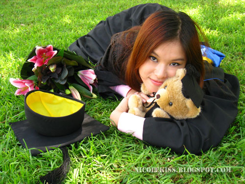 graduation photo_frontal view lying on grass