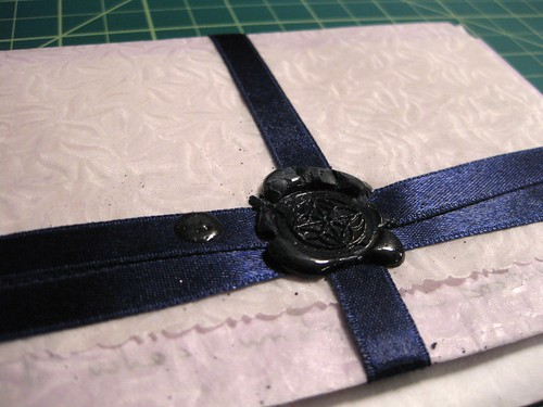 Ribbon and wax seal, inside envelope closeup