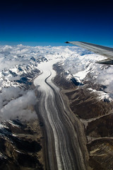 Glacial superhighway (Lil [Kristen Elsby]) Tags: pakistan mountain snow mountains ice clouds plane airplane landscape flying inflight asia aircraft flight wing aerial glacier alpine getty pia topv11111 topf150 himalayas gettyimages glacial southasia himalayanrange baltoro baltistan airsafari baltoroglacier gilgitbaltistan gettyimagesonflickr canong12