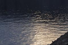 Light on black waters (~Maninas) Tags: light sea seascape black stone landscape island coast nikon waves croatia karst pag dalmatia aftersunset dalmatiancoast sooc maninas d5000 april2011