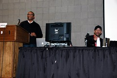(l to r) Reggie Hudlin and Denys Cowan, with Jim McCann hiding behind the monitor