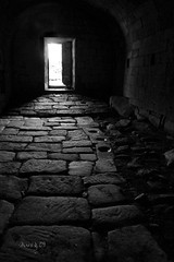 Escape (_madmarx_) Tags: door light luz stone architecture arquitectura bn galicia monastery porta pedra retocada mistery mosteiro ourense meln madmarx santamarademeln