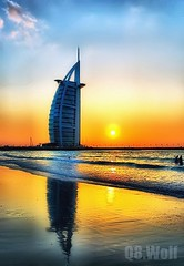 Dubai + SunSet (Q8.Wolf ~ No Longer) Tags: sunset sea sun reflection tower set wolf dubai waves uae burjalarab burj q8 alarab addictedtoflickr colorphotoaward goldstaraward q8wolf