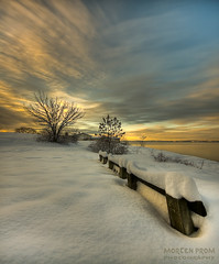 Snow Covered Bench at the Oslo Fjord (mortenprom) Tags: ocean morning winter light sea sky orange sun house snow plant black color reflection tree ice beach nature water yellow oslo norway stone clouds sunrise bench landscape island golden norge gate skandinavien norwegen wideangle explore shore noruega february scandinavia peninsula 2009 goldenhour oslofjord bygdy habour huk noorwegen noreg wideangel sigma1020mm skandinavia supershot nd1000 nd30 bw110 platinumphoto canoneos40d nd1000x naturaldensityfilter vosplusbellesphotos mortenprom obramaestra