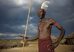 Pokot tribe chieftain with an ostrich feather on the head - Kenya (Eric Lafforgue) Tags: africa wood storm clouds canon village kenya seat chief flash feather culture tribal pillow chef tribes afrika tradition tribe nuage ethnic tabouret bois tribo ringflash autruche headdress plume afrique headwear ethnology headgear tribu eastafrica headrest coiffe pokot qunia 7406 lafforgue ethnie  qunia    kea   pokhot teppete appuienuque  a