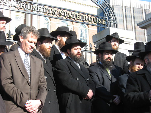 Sen. Brown with local Chabad Rabbis at a Peace Vigil in Front of the State House by State Senator Scott Brown.