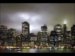 Send in the Clouds (9/11) (Linus Gelber) Tags: nyc sky mist newyork fog skyline night clouds lights memorial manhattan worldtradecenter towers 911 eastriver twintowers beams tributeinlight 911memorial canon28135mmisusm tributeinlight2009 gsubby122109