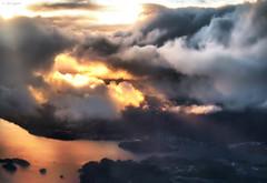 Cataclysmic Bergen! (larigan.) Tags: sunset sea rain clouds aerial fjord bergen fireinthesky badweather flesland cataclysm abigfave anawesomeshot larigan phamilton roughflight bergenlesund orwasitontheground