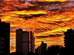 Fire! Fire! Fire! (peggyhr) Tags: blue sunset brazil sky orange yellow clouds buildings reflections silhouettes curitiba pr kriskroscontacts peggyhr canonpowershotsd880is 20090129 0587fa hdrpspostprocessing