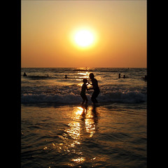 Untitled (JannaPham) Tags: ocean sunset sea vacation sun india reflection beach water silhouette sunrise canon eos golden dance jump goa explore emotions project365 majorda explorefrontpage 40d jannapham