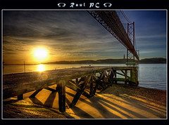 A pier and a bridge under sunrise :: HDR (raul_pc) Tags: portugal water gua canon eos lisboa lisbon sigma raul tejo 1020 ponte25deabril hdr 450d ilustrarportugal artistictreasurechest
