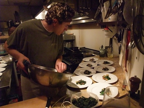 Art of the Table Chef/Owner Dustin Ronspies plates greens and gnocchi before adding the Maritime Nightwatch braised duck leg.