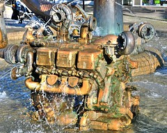 Big Golden Engine (Habub3) Tags: travel holiday water fountain metal germany deutschland golden photo nikon wasser europa europe springbrunnen engine skulptur motor bodensee metall marktplatz reise mtu lkw friedrichshafen d300 lakeconstanze viewonblack habub3 vanance