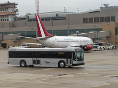 Xtra Airways and a NWA Shuttle Bus (MSPdude) Tags: bus minnesota canon airplane gate northwest aviation powershot airline shuttle boeing gillig charter 737 737400 xtraairways n42xa s5is
