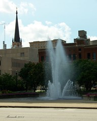 Fountain of Louisville (marinela 2008) Tags: city flowers blue trees summer vacation sky tower church water fountain clouds turn buildings square drops day purple crane streetlamp cityhall kentucky sunday jet august louisville splash apa petunias biserica cladiri excursie strop copaci vacanta fantana stropire
