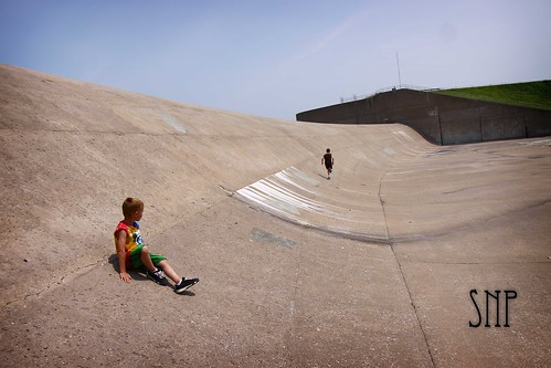 . playing in the spillway .