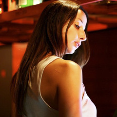 Giving Me the Warm Shoulder (rho_L) Tags: red woman hot beautiful bar hair warm profile chick tanktop dame shoulder broad seductive bartender canonxti