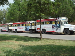 bus train (tango 48) Tags: road trees red bus green train carriage towpakistanislamabad