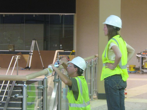 Camille installing, with Alan B. Davidson, the interactive touch railing for her latest project at the West End in St. Louis Park, MN