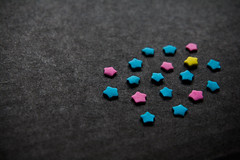 the intruder (ion-bogdan dumitrescu) Tags: pink blue wallpaper black macro colors yellow stars star flickr colours different dof sweet background sprinkles shape intruder superstars sprinkle bitzi strs ibdp mg0230 sortofminimal suprstars findgetty ibdpro wwwibdpro ionbogdandumitrescuphotography
