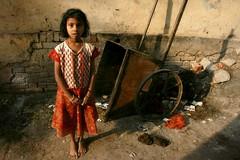 Kashi (fredcan) Tags: street morning travel light india girl standing kid garbage child indian posing dirt alleyway rubbish sacred varanasi kashi gali dung profane benares southasia uttarpradesh cowdung indiansubcontinent theoldestlivingcity thisiskashi