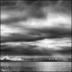 A Light Breaks on the Horizon (ecstaticist) Tags: ocean bw usa cloud white canada black mountains water vancouver de island washington ray shine bc juan horizon spoke surface sharp casio mount rays olympic penninsula glimmer sheen hdr strait fuca tolmie 5x photomatix tonemapped tonemapping exf1